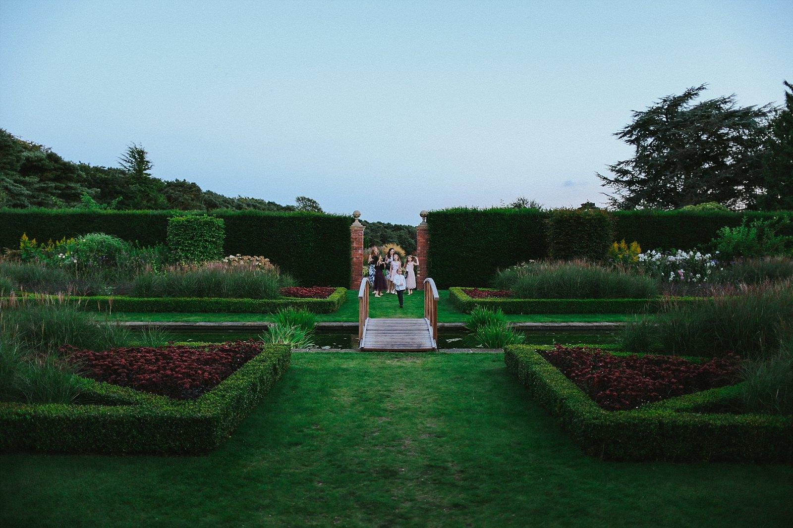 Abbeywood Estate gardens at dusk with children running around it