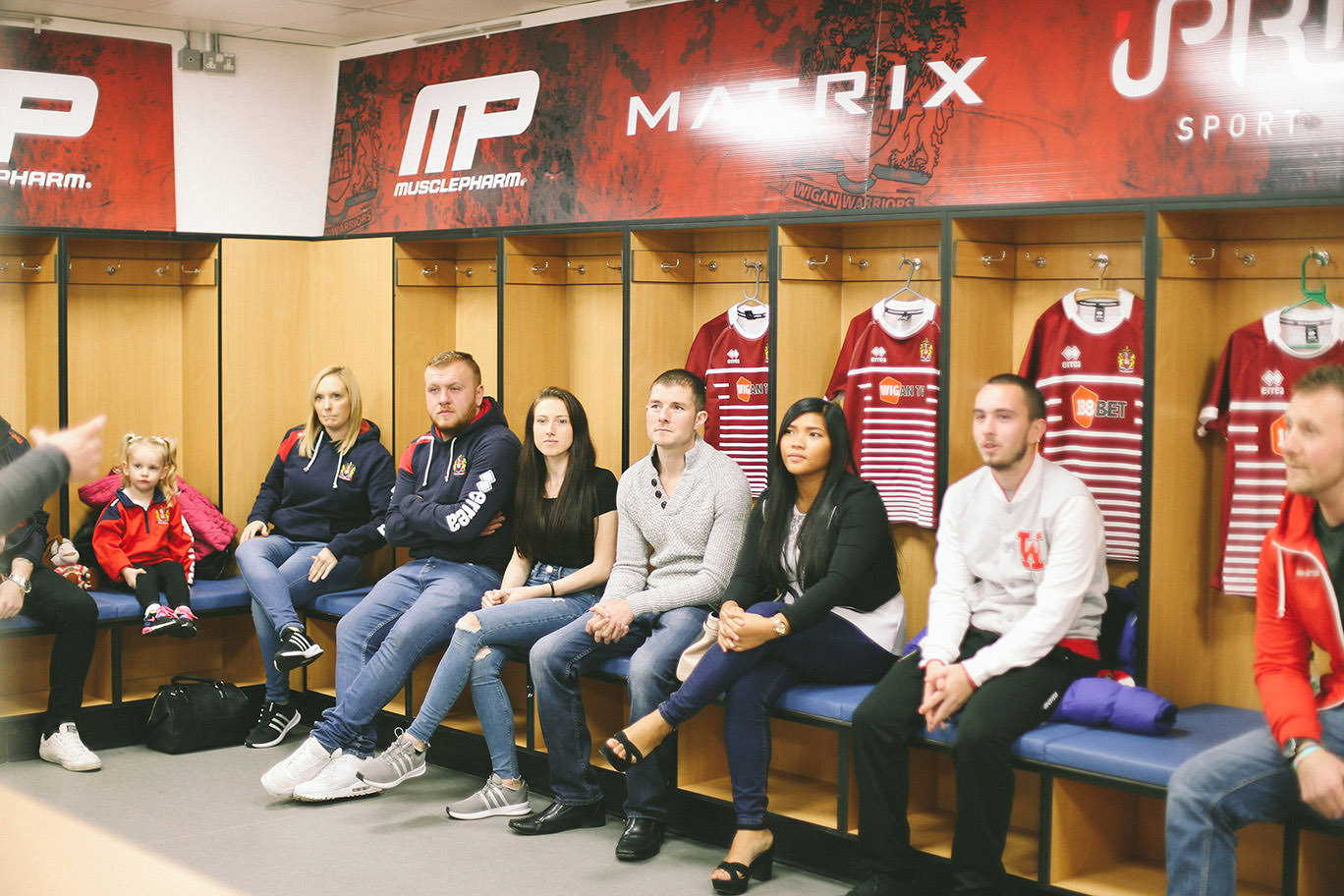 Fans in dressing room at Wigan Warriors for photo shoot