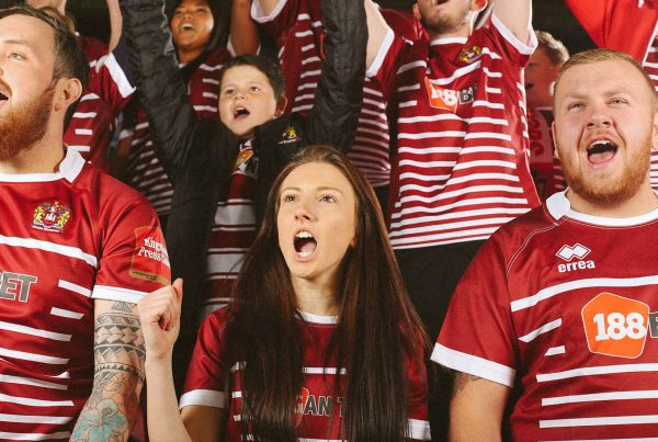 Cheering crowd shot for the new Wigan Warriors rugby kit launch