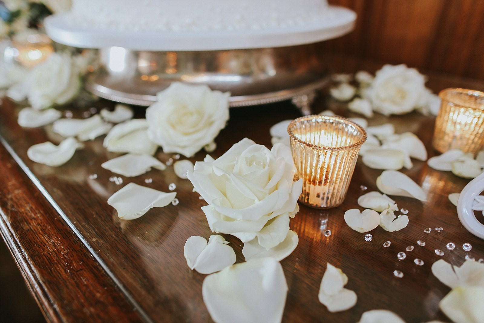 tea lights and white roses on a table