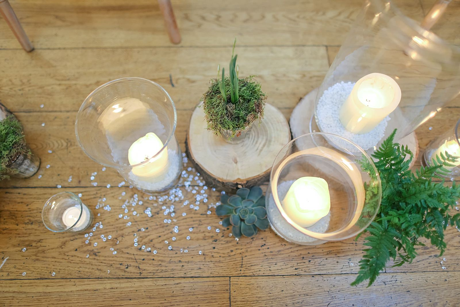 aisle details of logs plants and candles in jars
