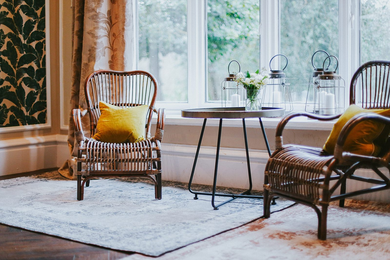 Wicker chairs in dining room with a table