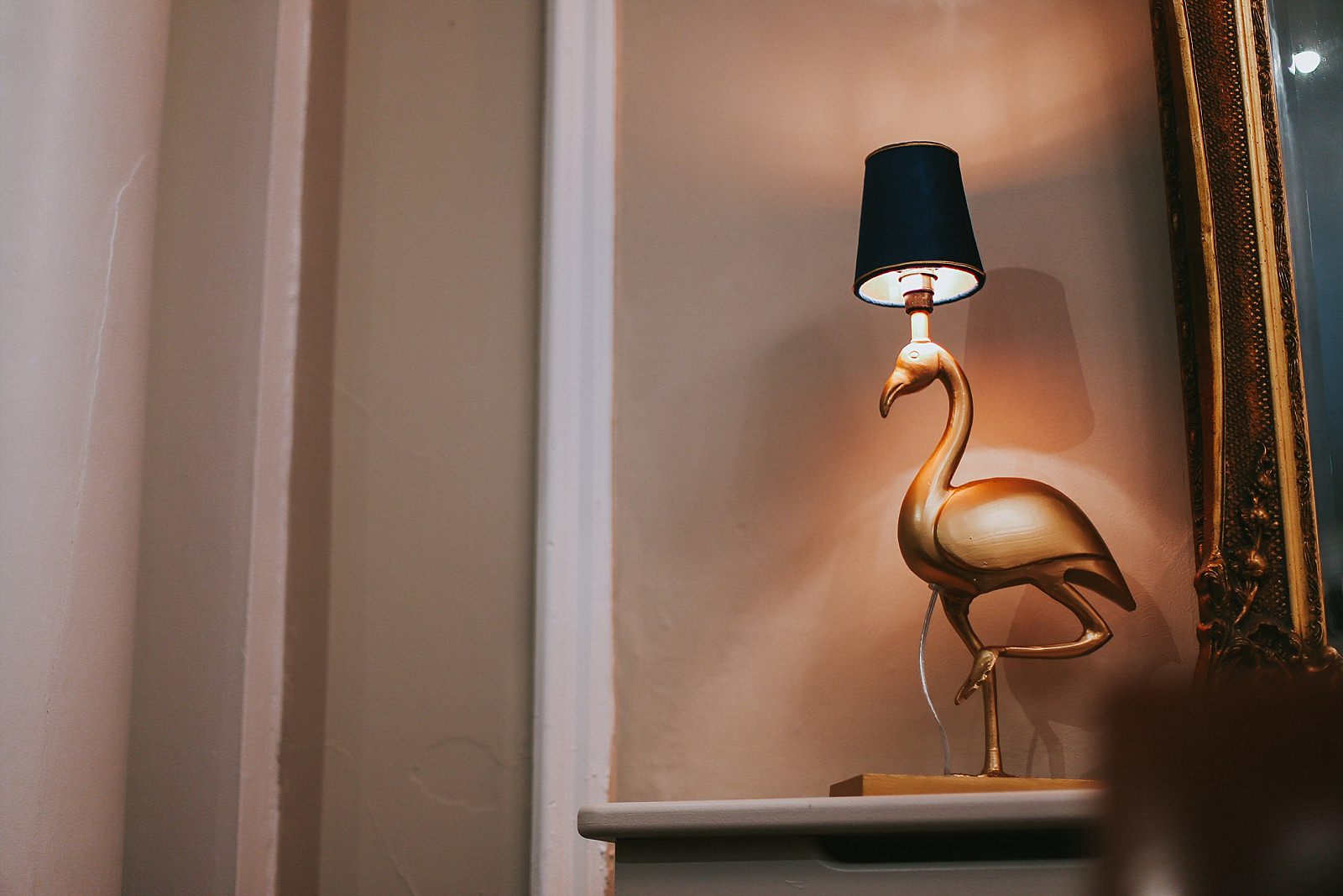 Gold flamingo lampshade in a hallway