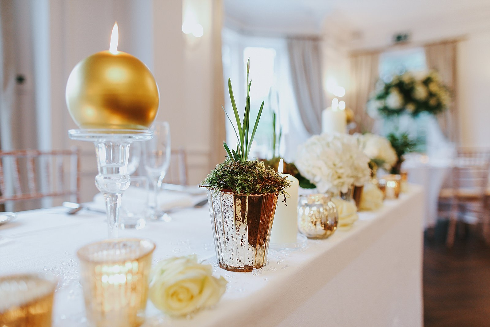 gold flower pots with flowers in