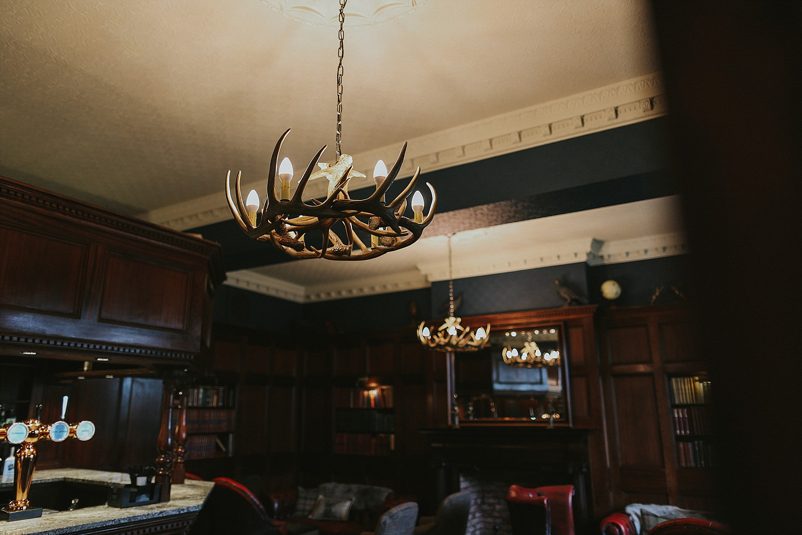 antler lamps hanging from the roof in a bar
