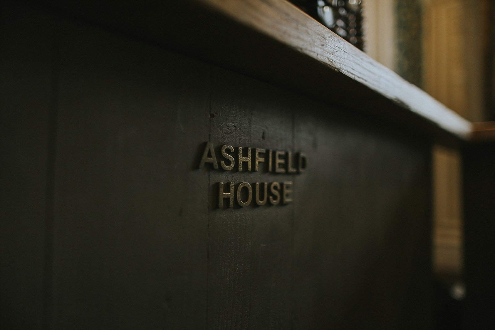 ashfield house in wigan logo on a table
