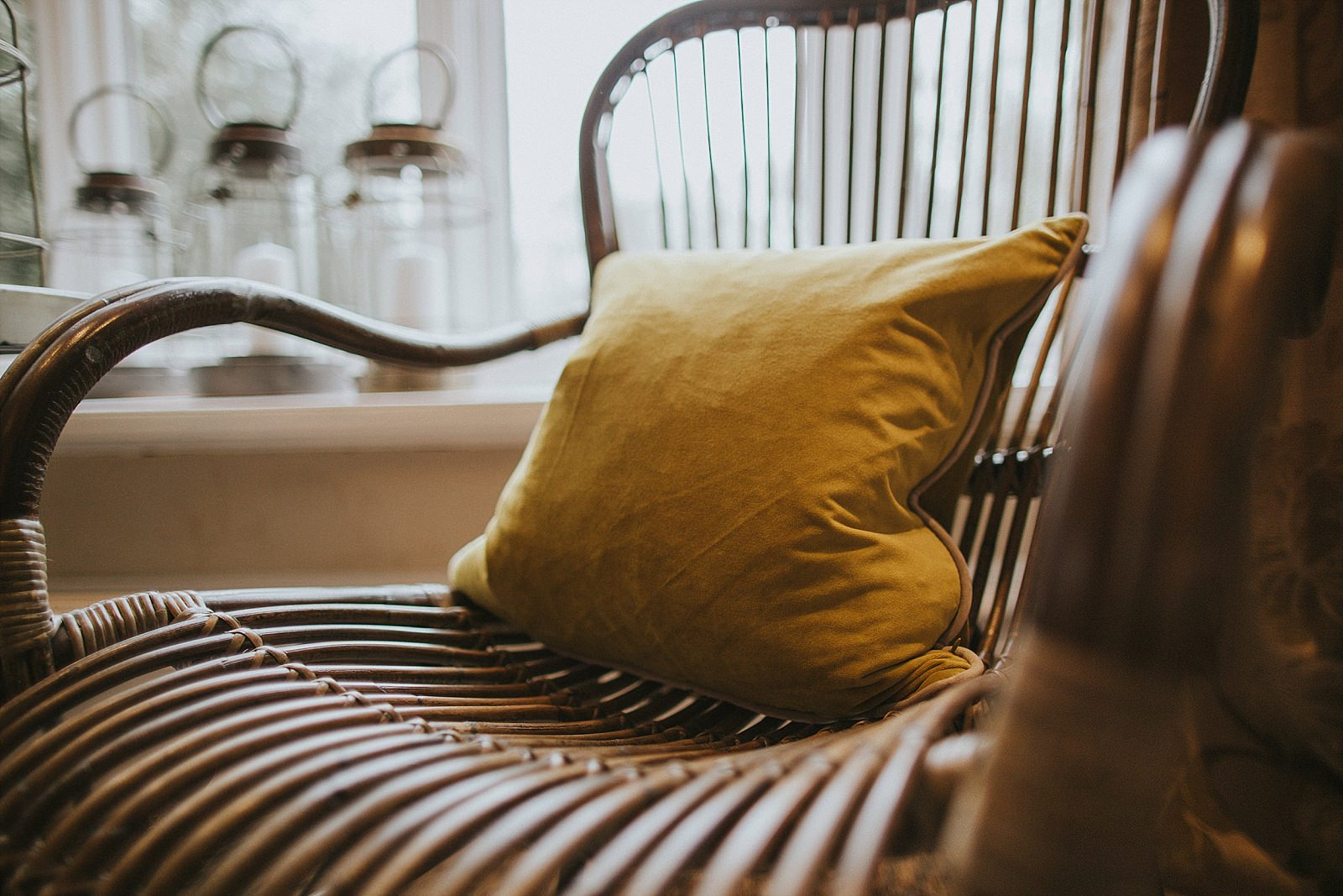 mustard cushion on a wicker chair