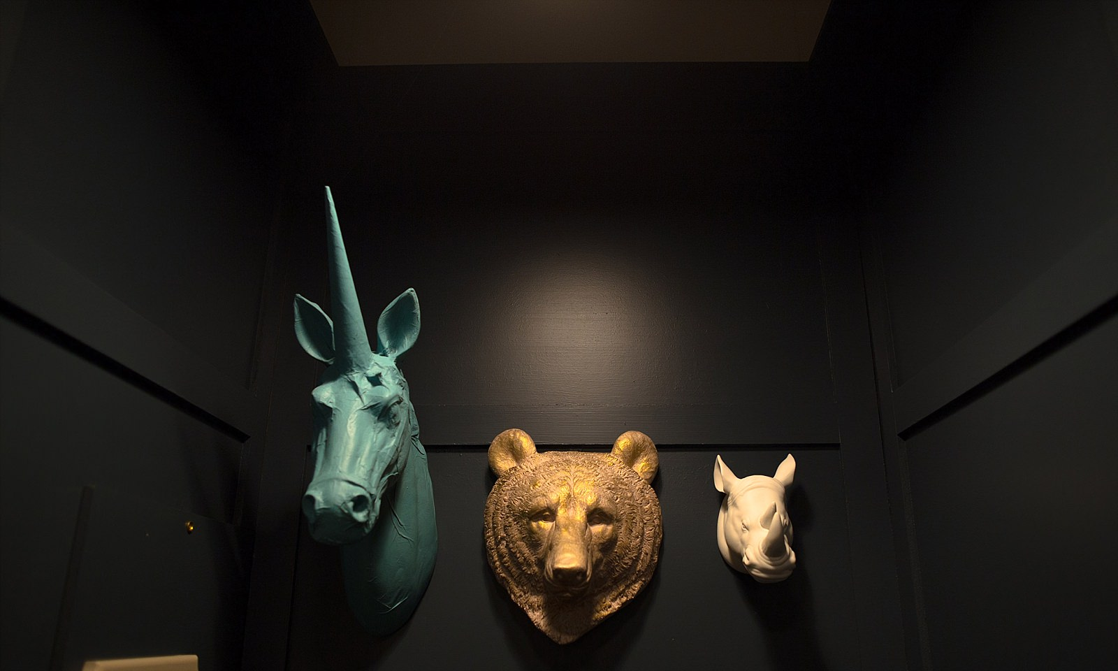 Animal heads in baby changing room