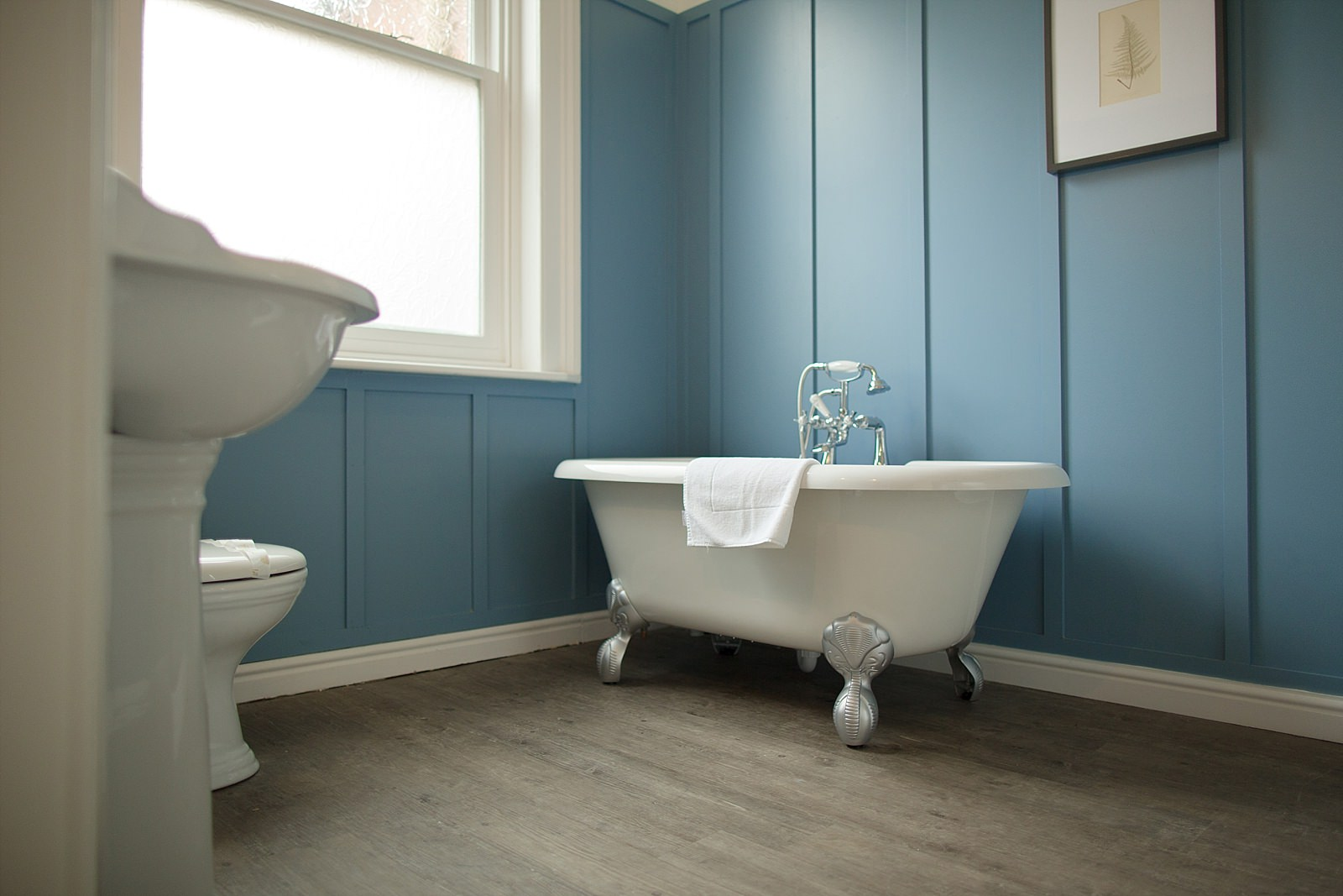 bath in a blue bathroom