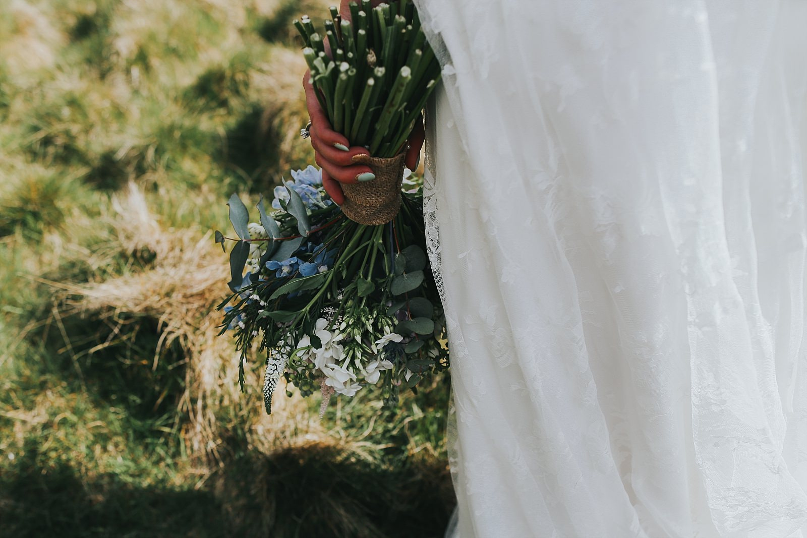 bride holding a flower bouquet