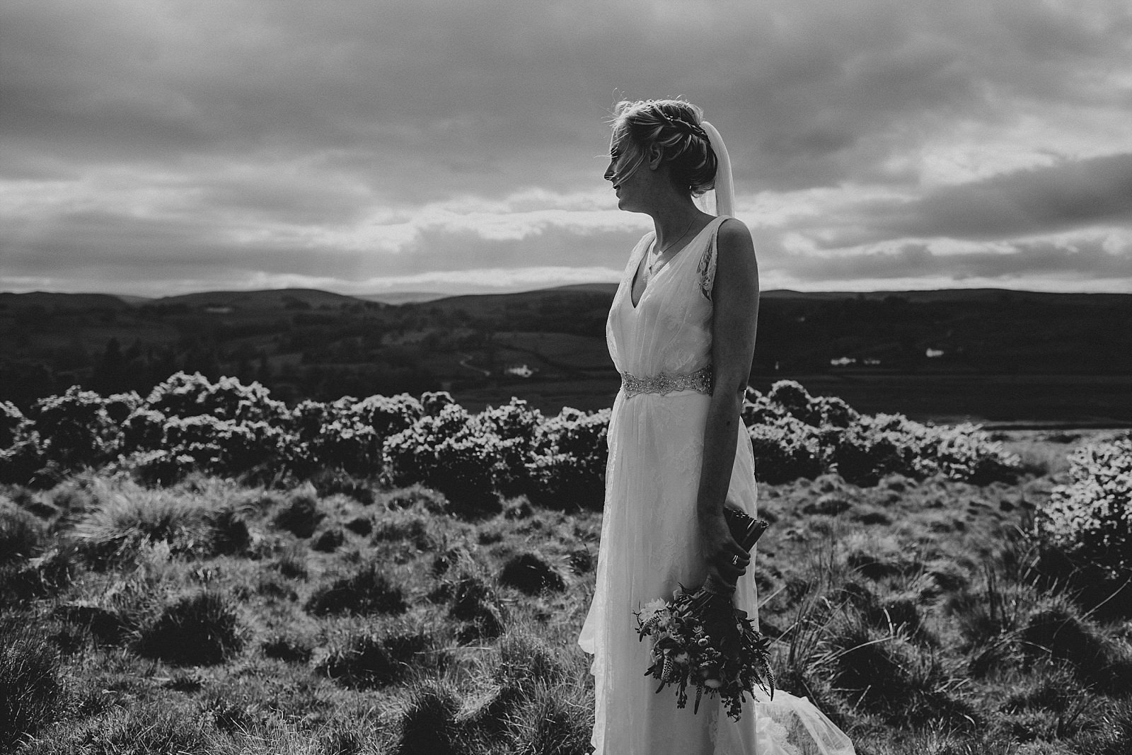 bride looking in to the distance on a moorside