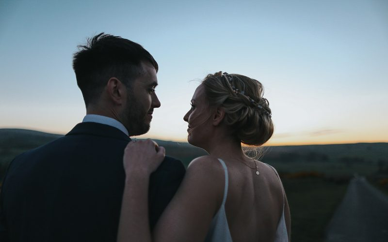 bride and groom looking in the sunset at knipe hall