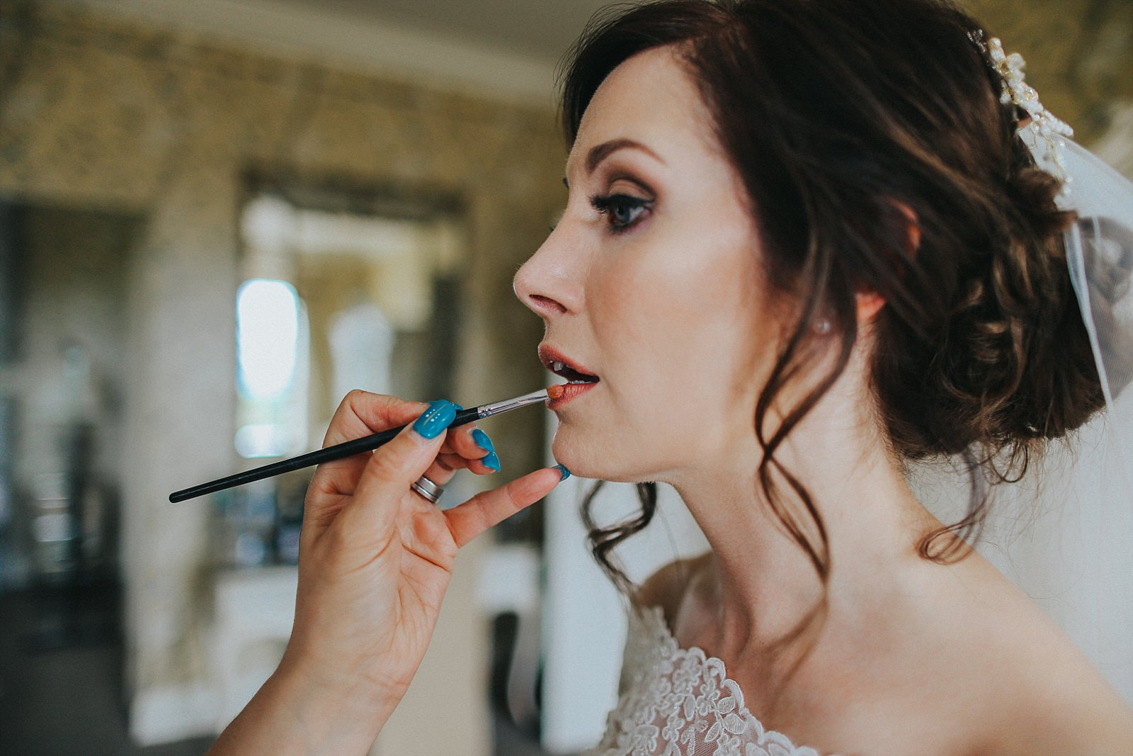 relaxed wedding photographer captures the bride and MUA