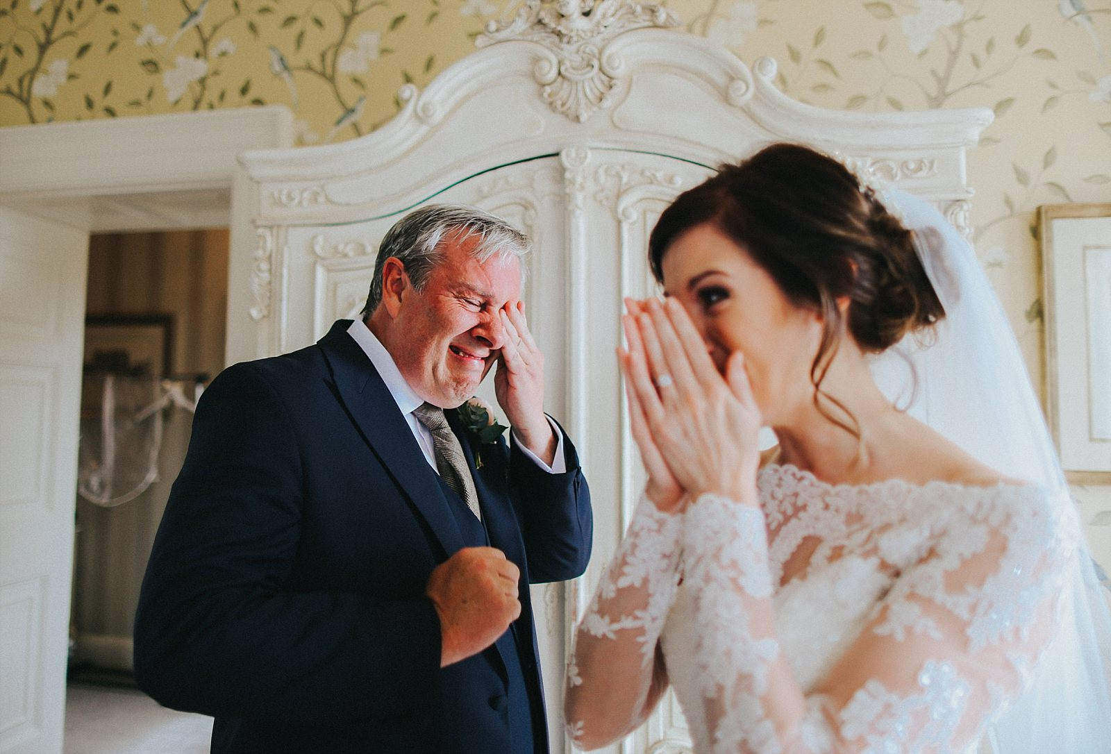 bride and dad crying for an emotional moment at eaves hall