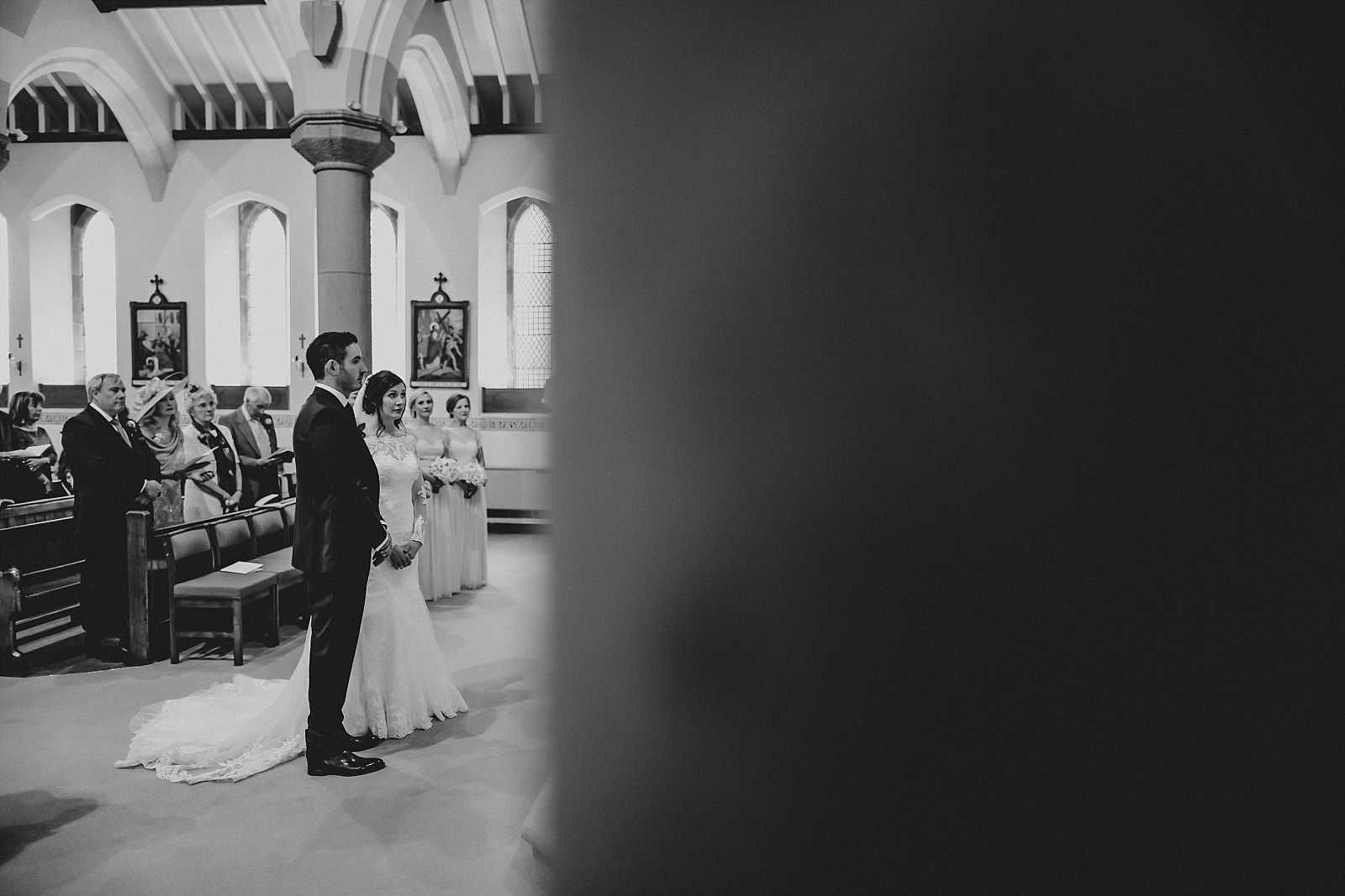 bride and groom standing at the alter in st wilfrids, longridge