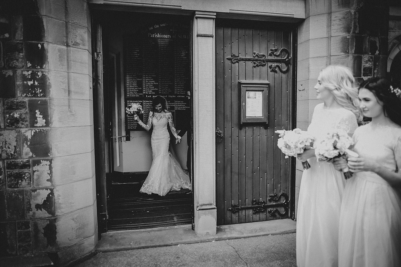bridesmaids await the newlyweds
