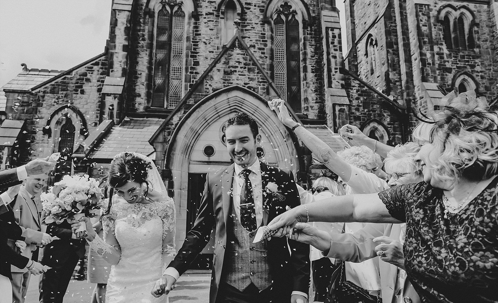 eaves hall wedding photographer captures confetti shit at st wilfrid's church clitheroe