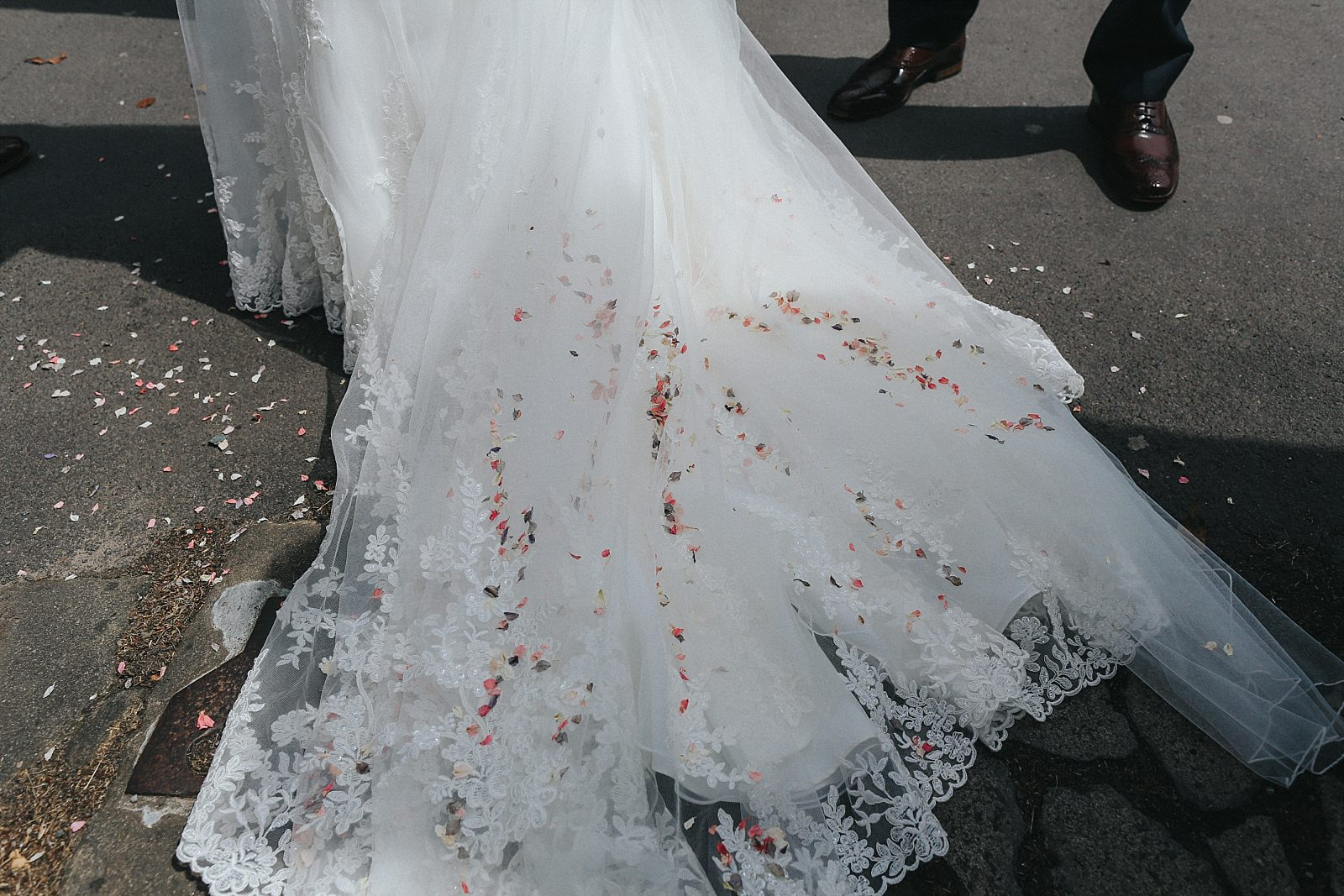confetti all over a wedding dress