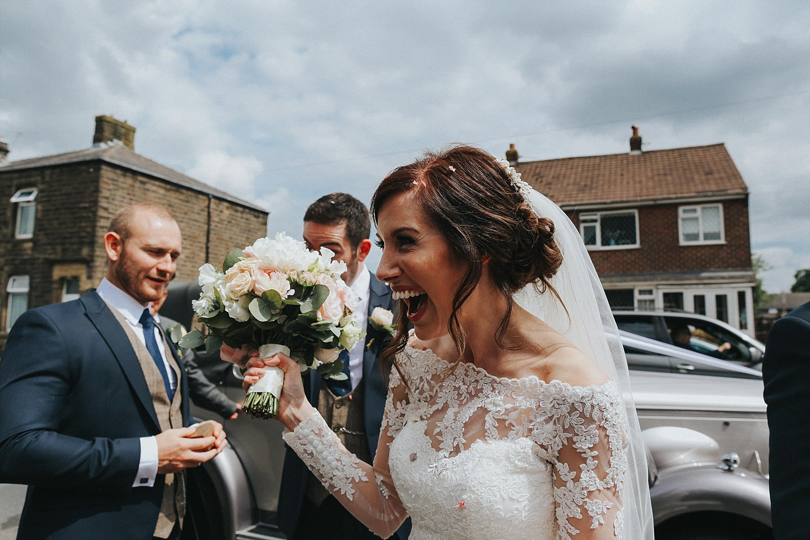 laughing bride with bouquet in her hand