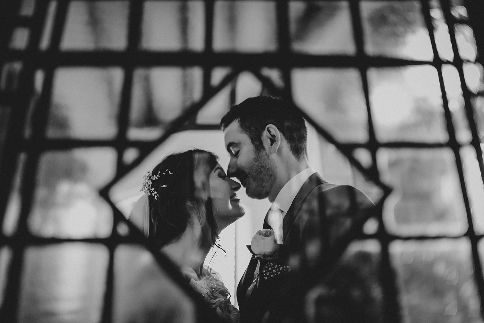 eaves hall wedding photographer uses the stained glass at st wilfrids churc, longridge