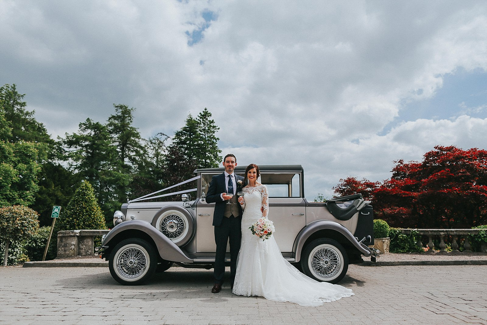 bride and groom with malvern wedding cars