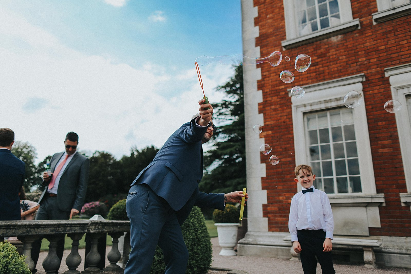 wedding guests have fun with bubbles