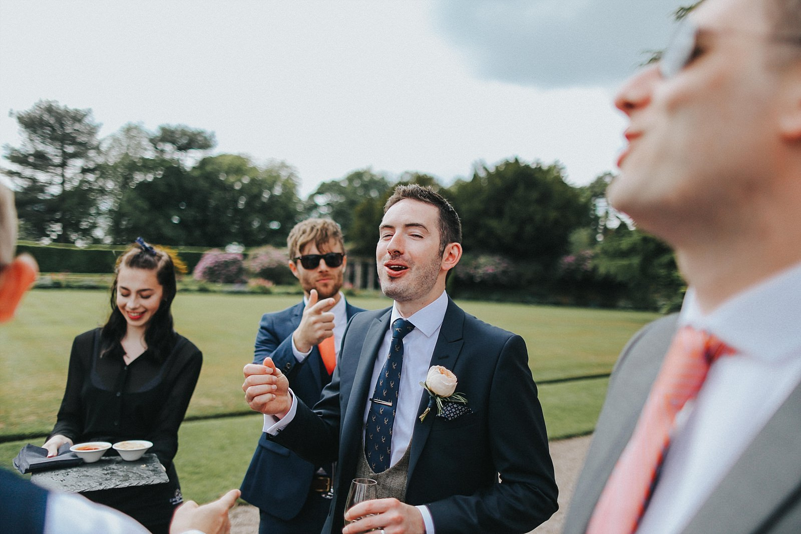 groom eating canapes