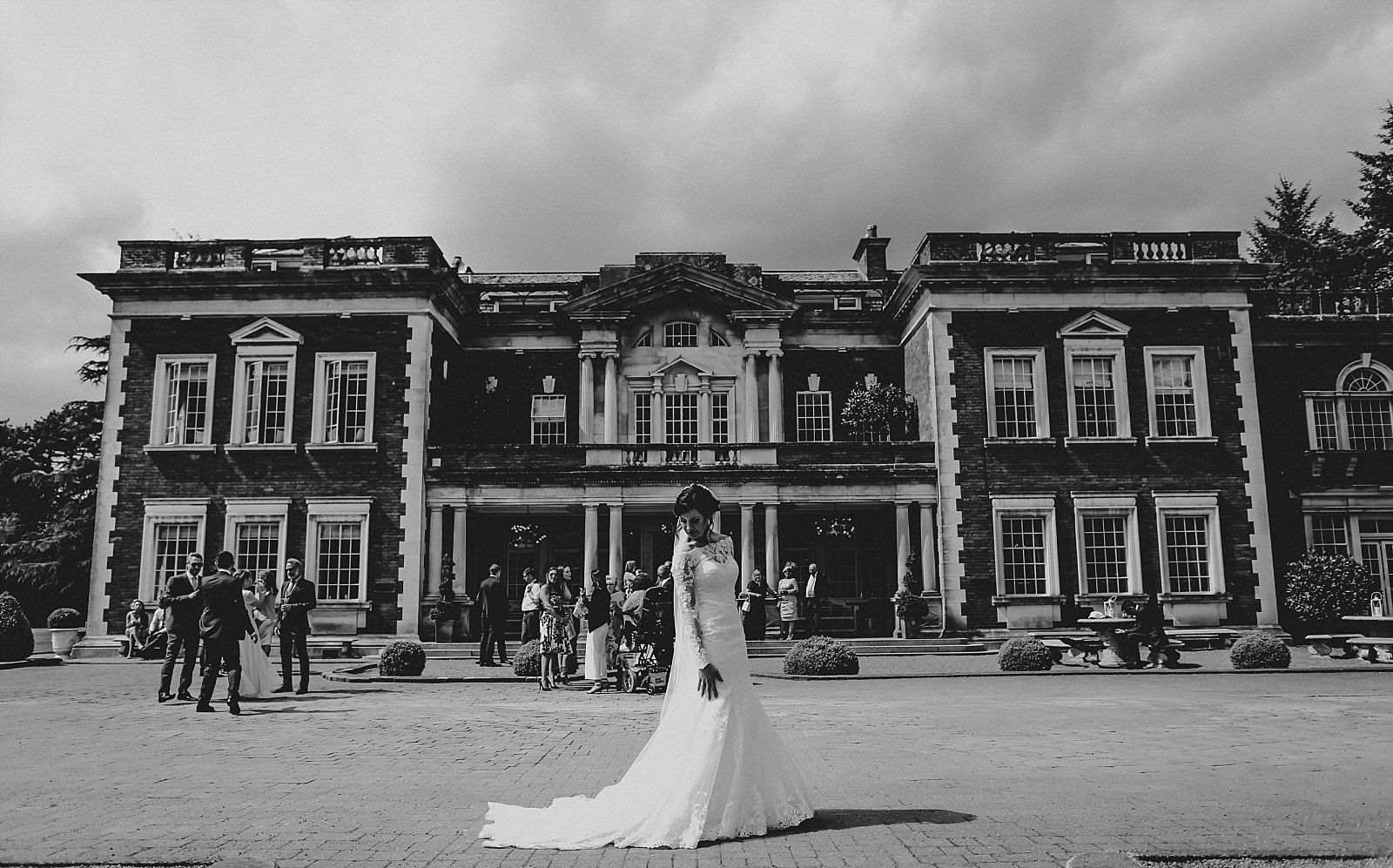 eaves hall wedding photographer captures the bride in front of eaves hall