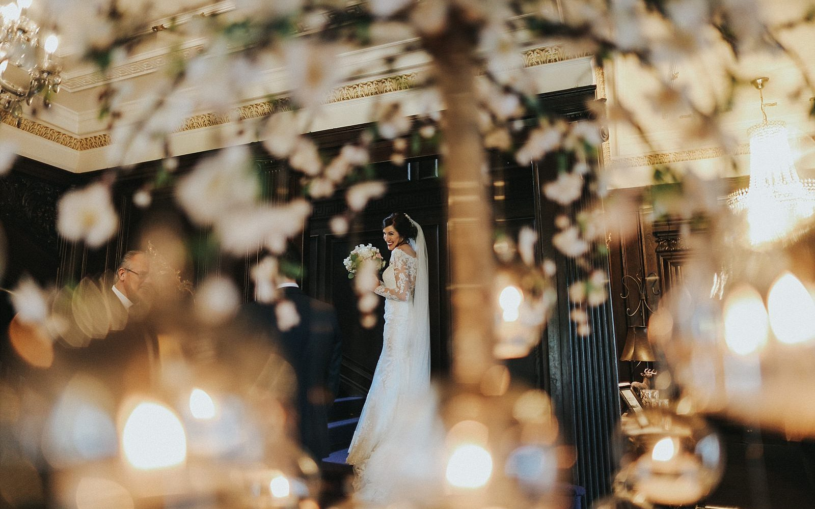 eaves hall wedding photographer captures the bride through the flowers