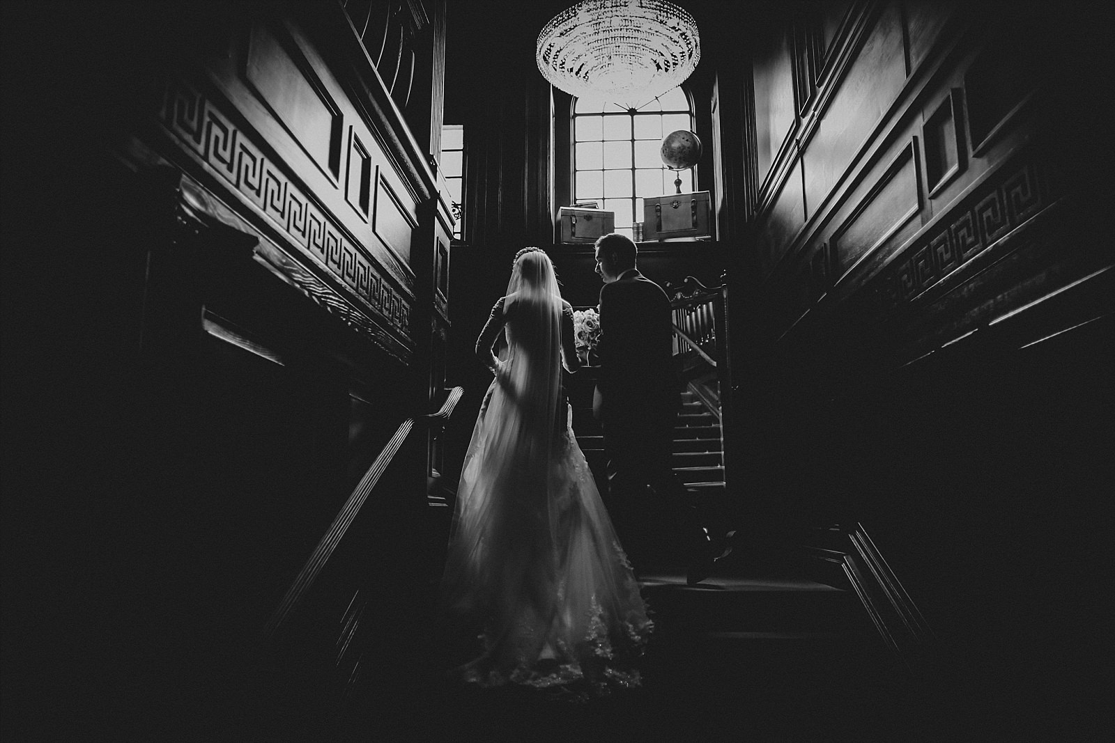 eaves hall wedding photographer uses the tremendous staircase at eaves hall