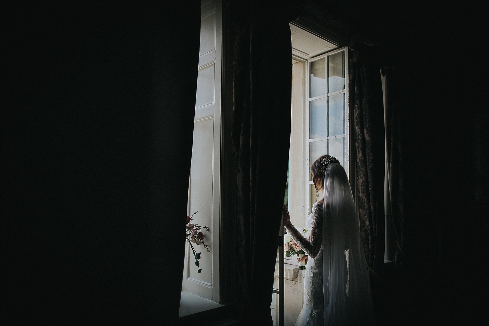 eaves hall wedding photographer captures bride in the bridal suite