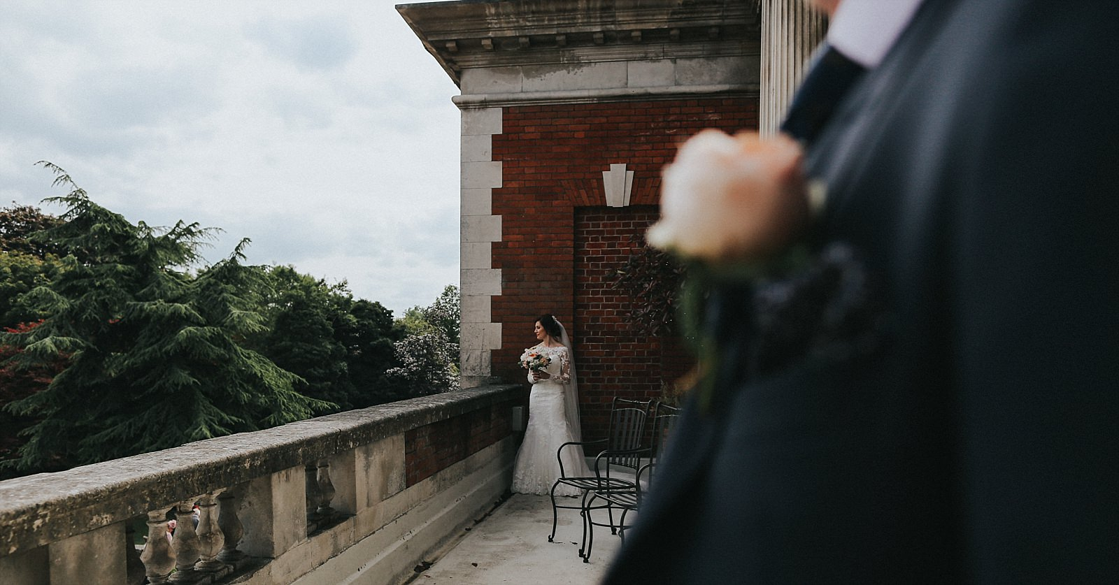 bride and groom on the balcony at eaves hall