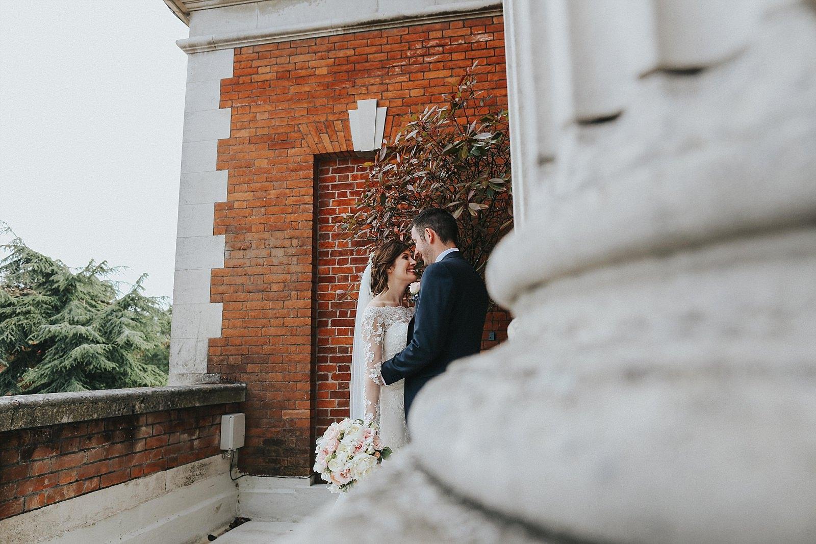 eaves hall wedding photographer spying on the newlyweds