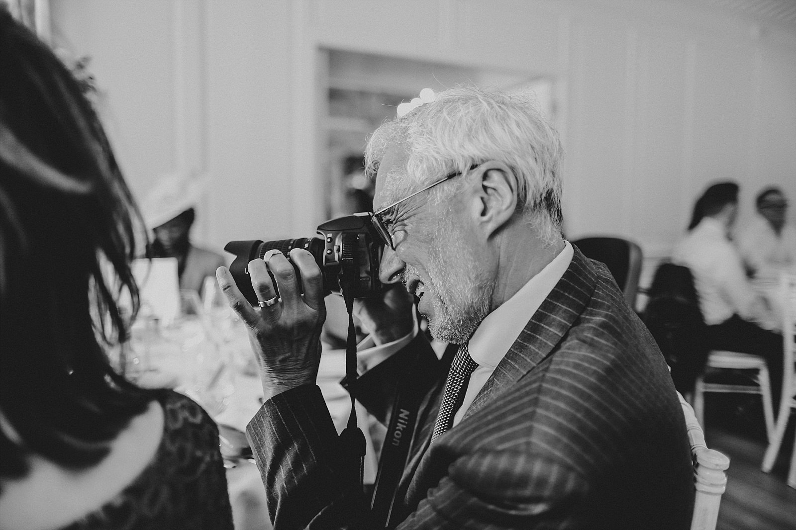 wedding guest being uncle bob with his camera