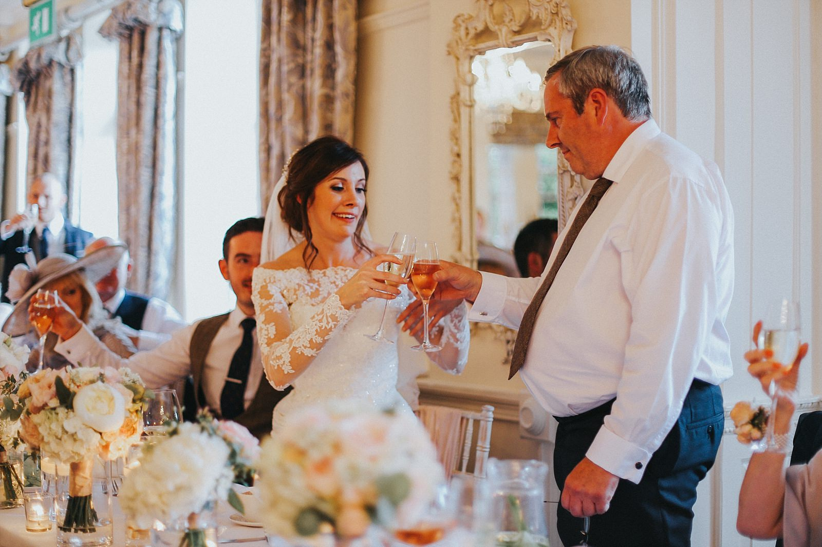 bride and her father toast
