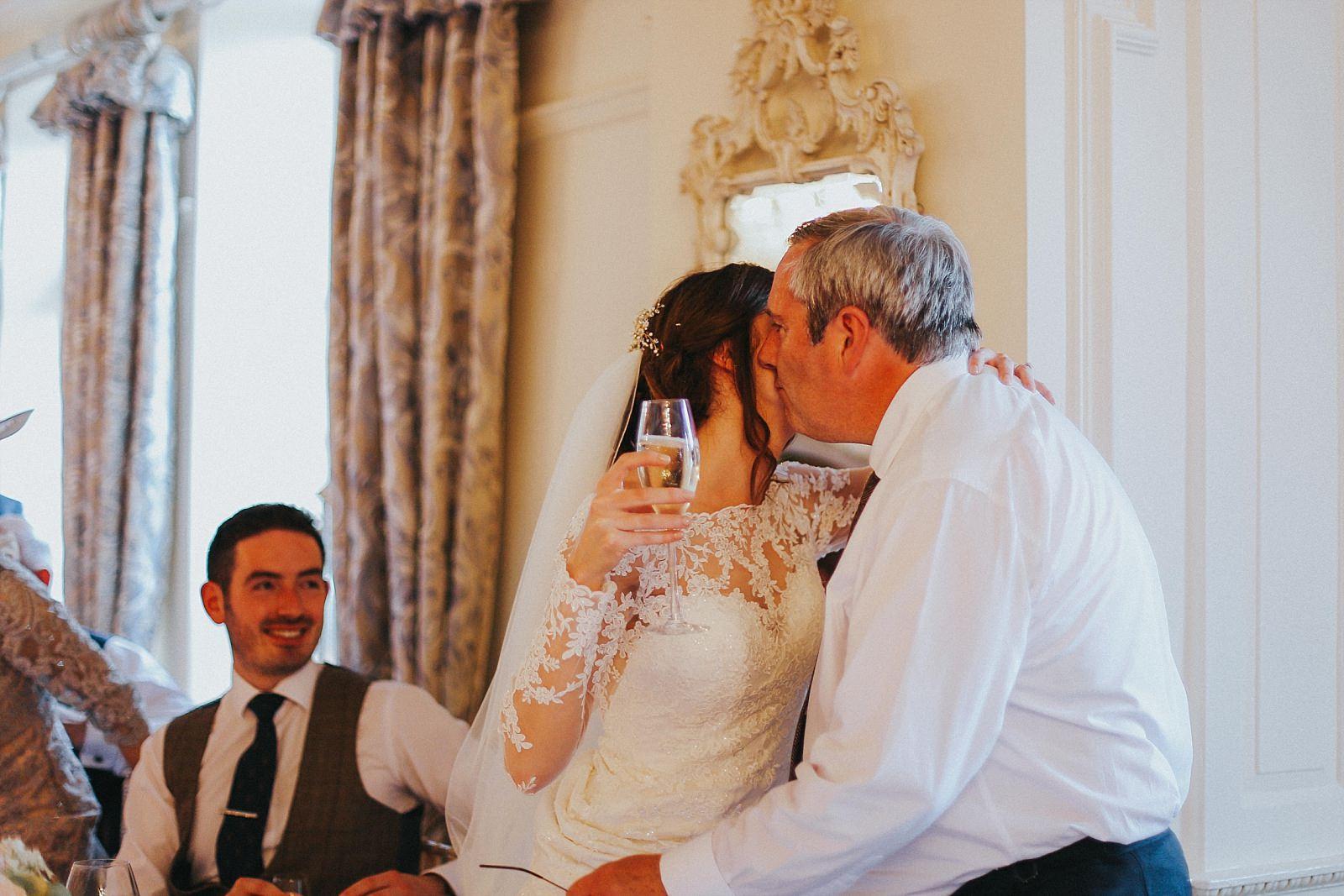 bride kisses father of the bride