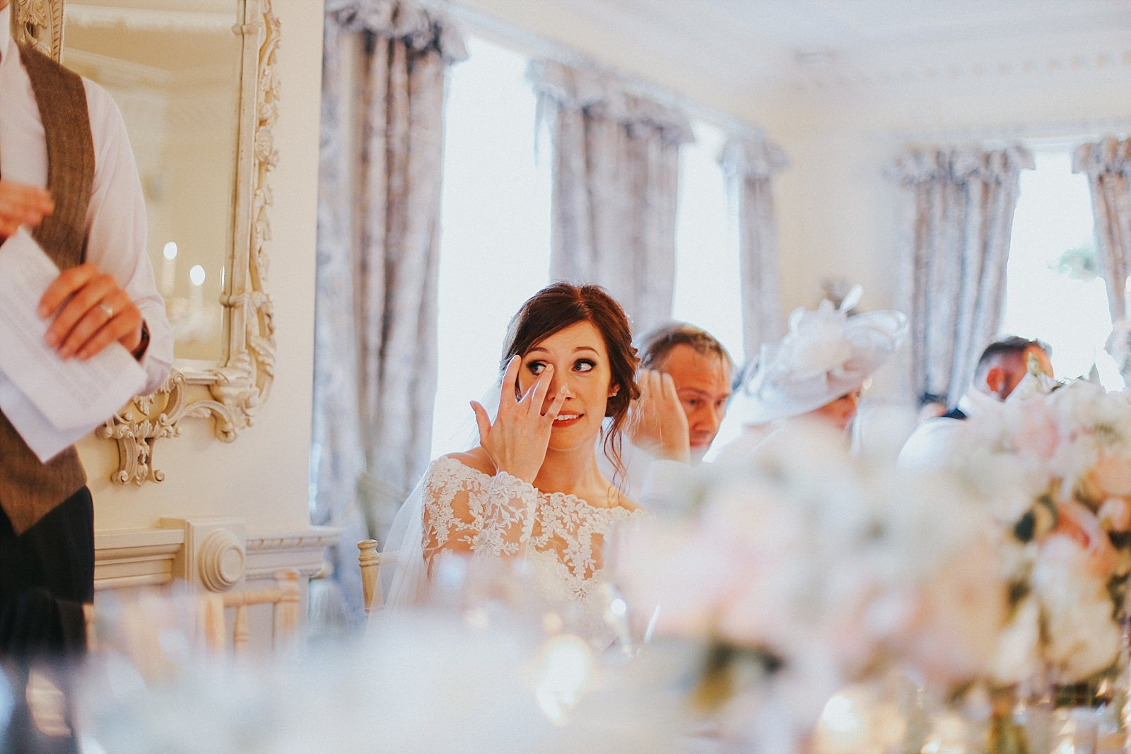 bride sheds a tear at the wedding speeches