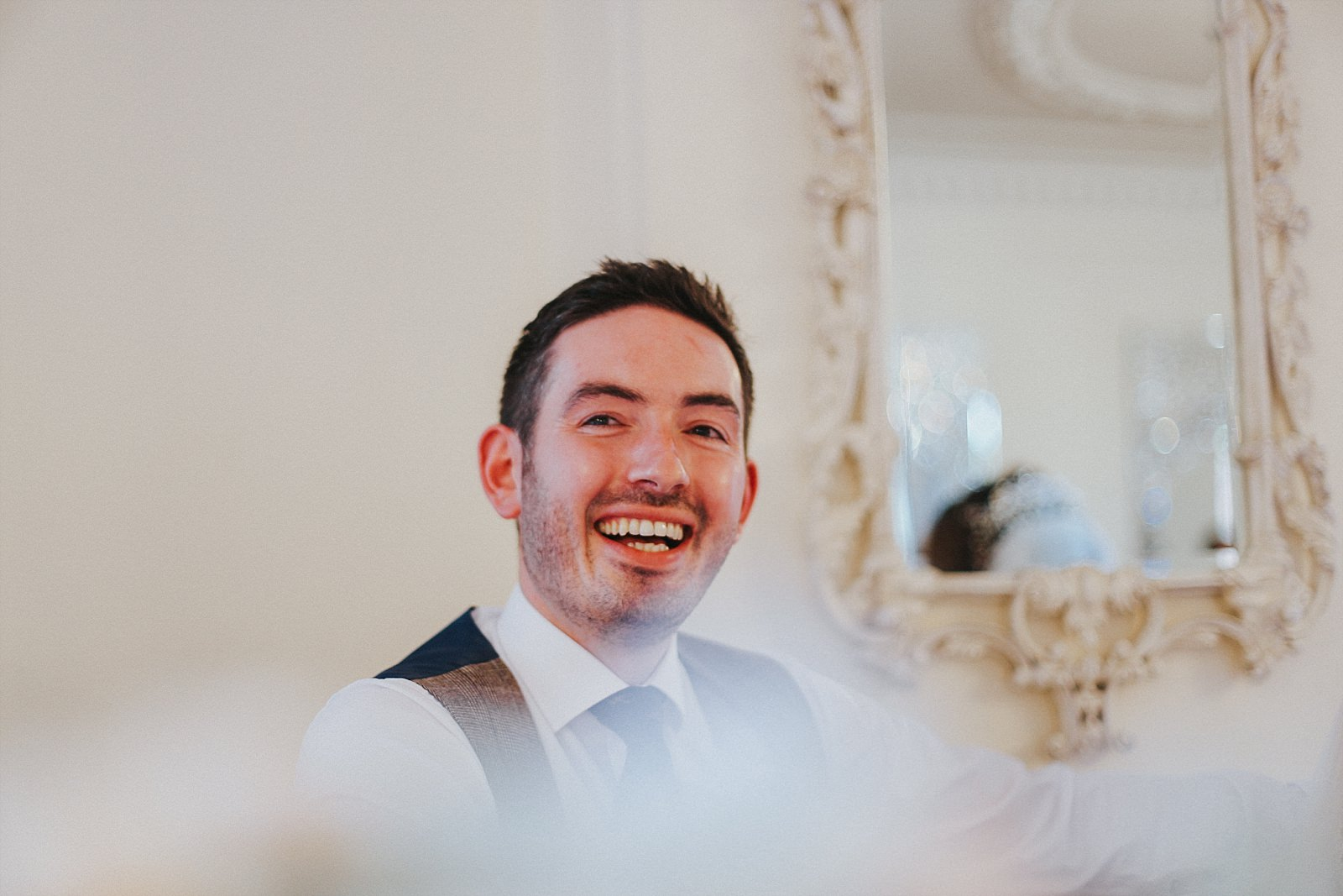 groom reacts to his best man's speech