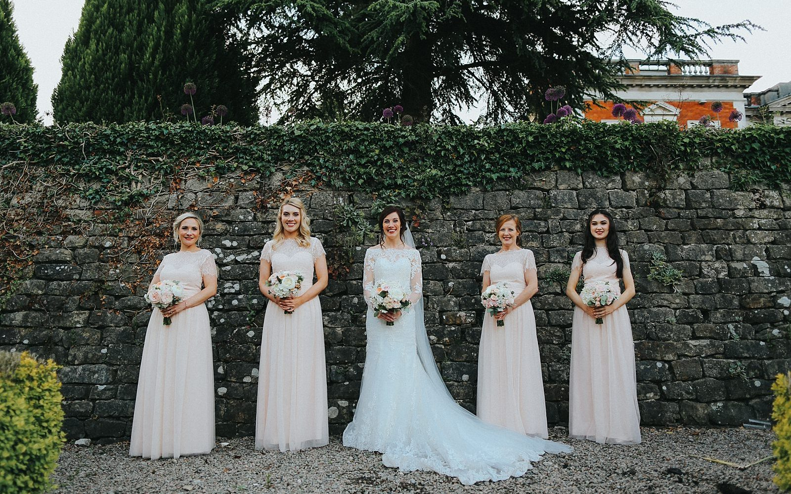 bridesmaids hold their bouquets