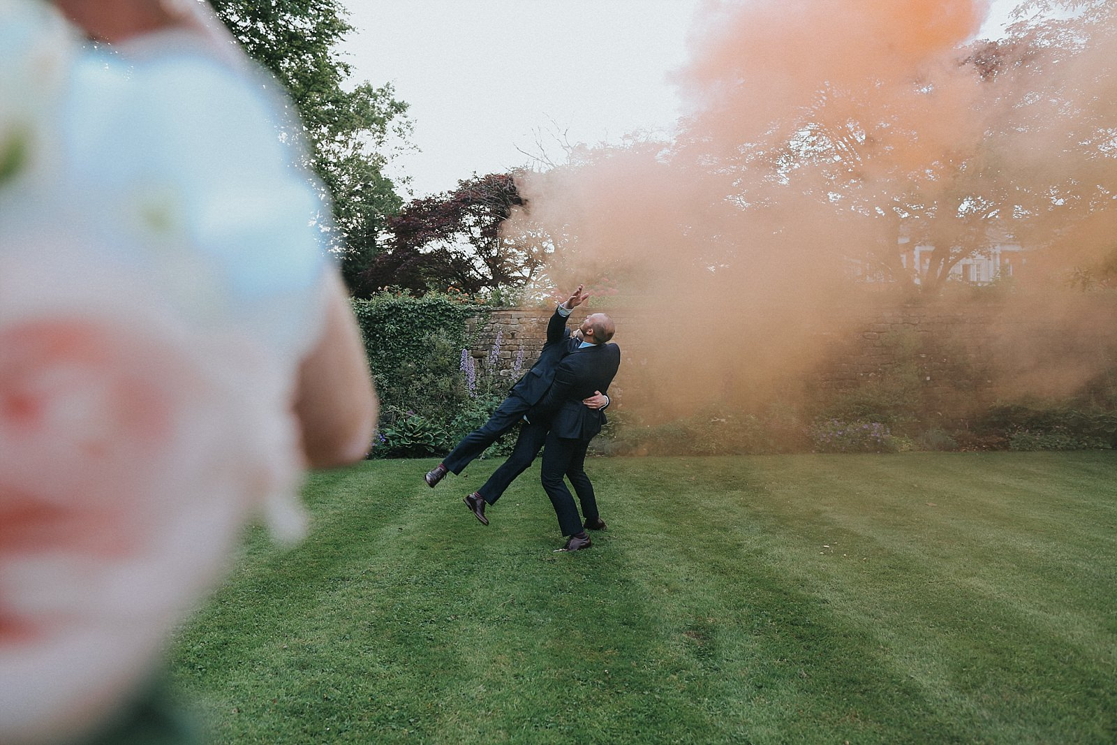 groomsmen having a laugh with the smoke bomb