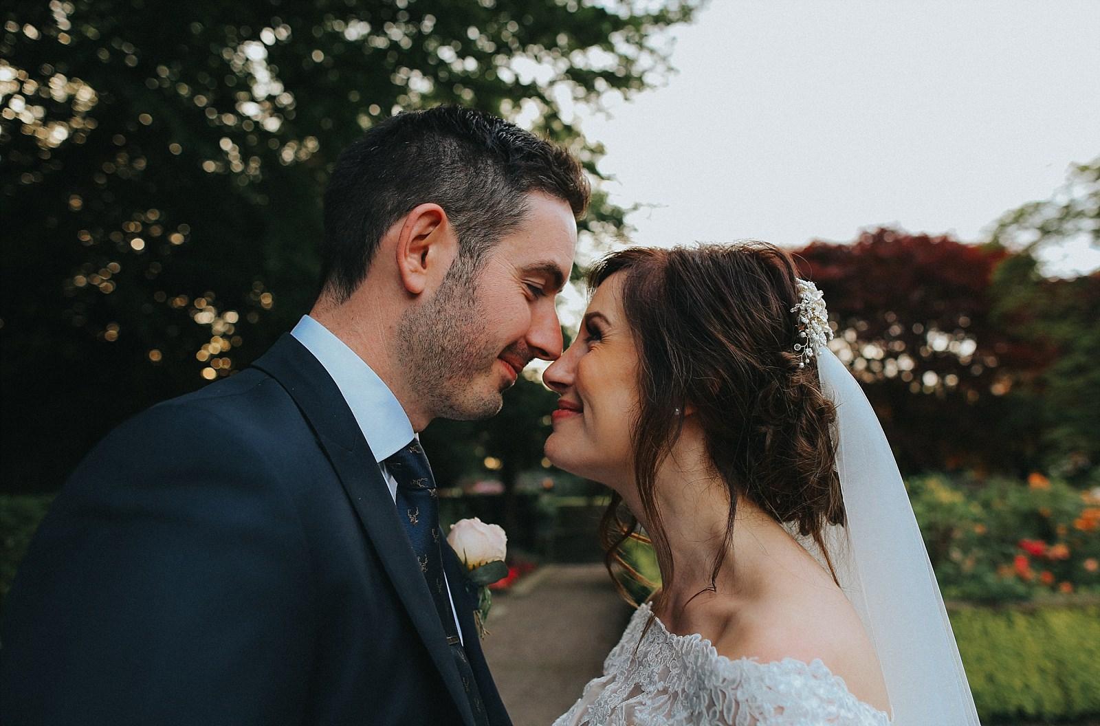 bride and groom Eskimo kisses
