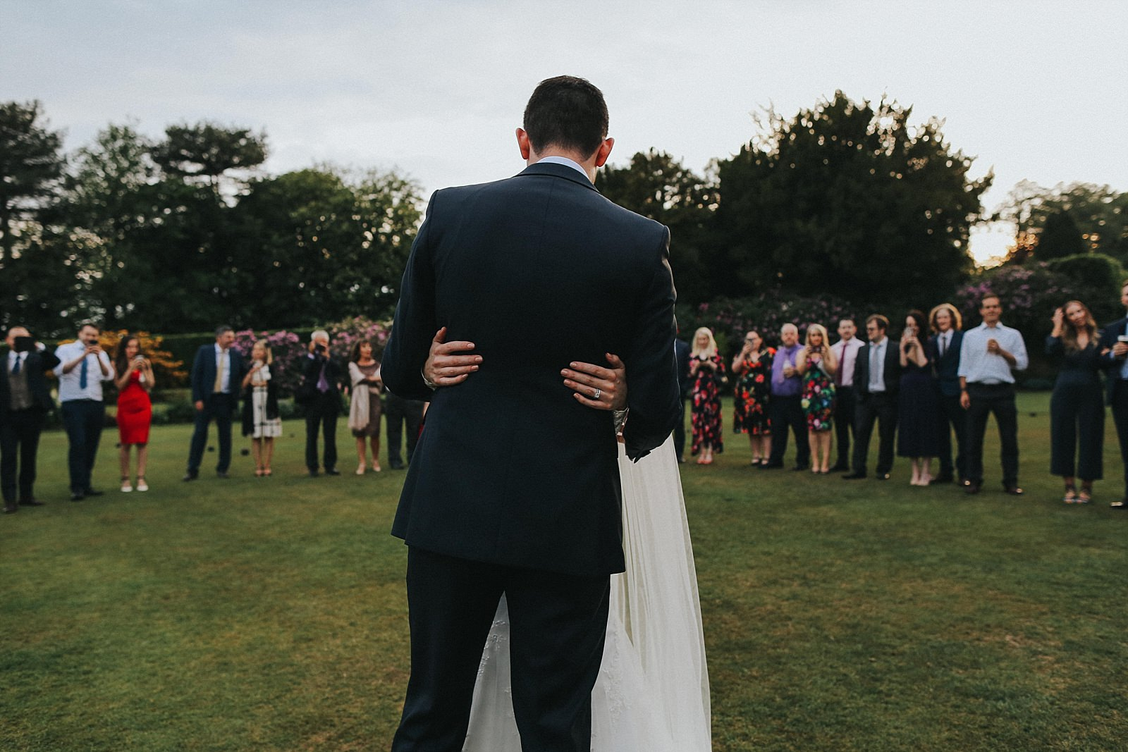 natural wedding photographer captures first dance on the lawn
