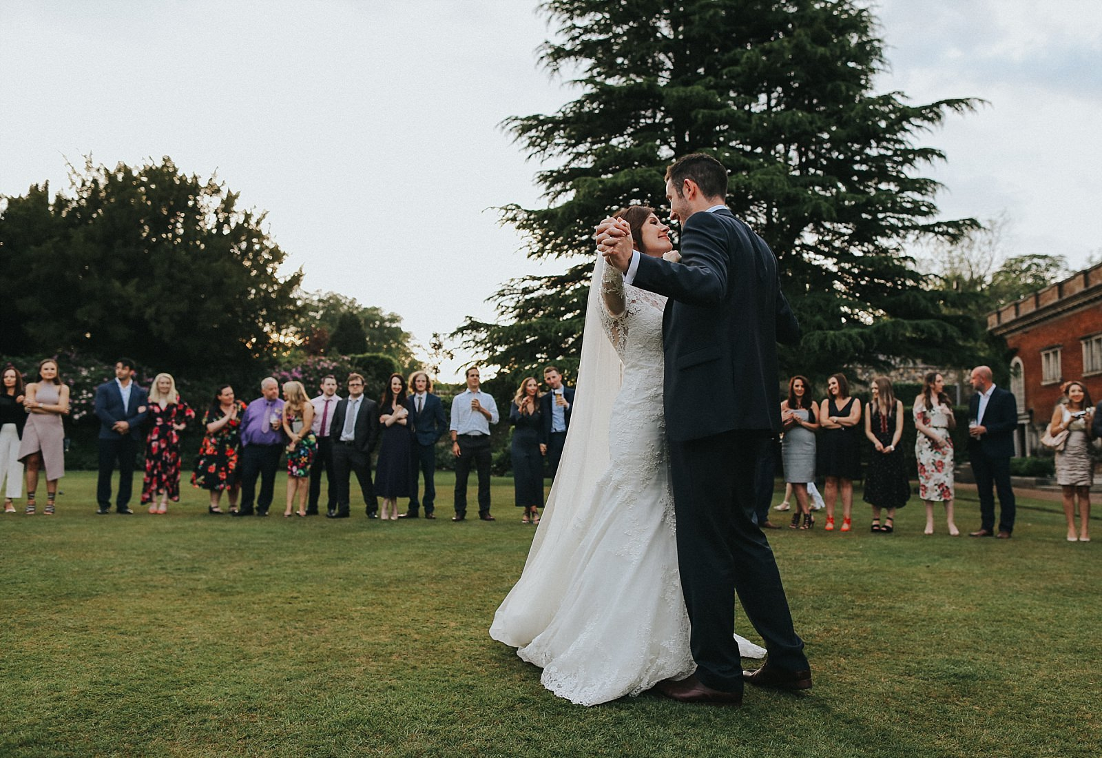 alternative wedding photographer captures first dance on the lawn