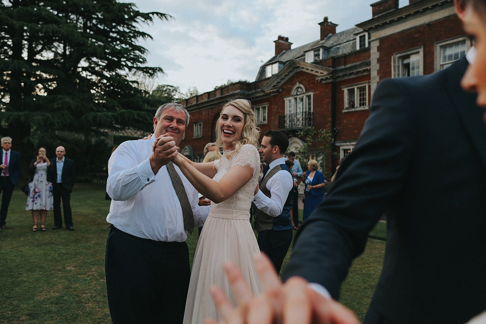 bridesmaid dances with her dad