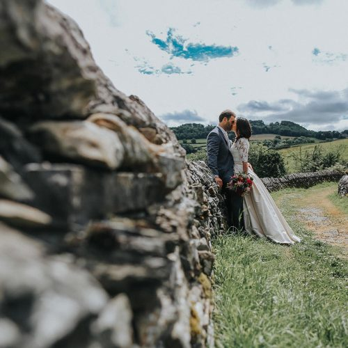 Lake district wedding photography ideas with couples in a field