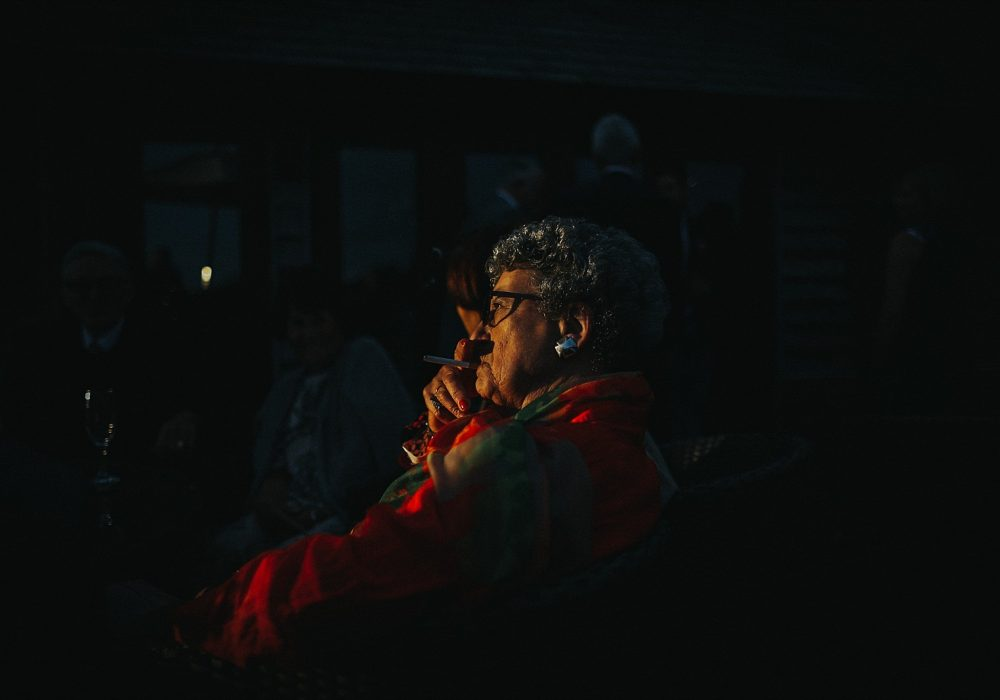 grandma watching in the shadows smoking