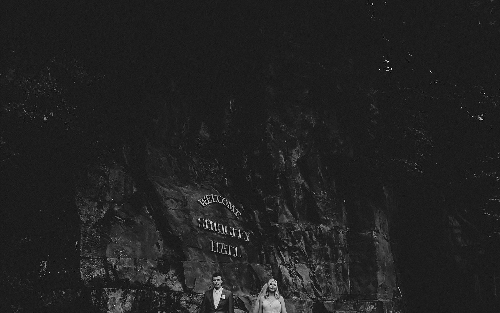 Shrigley hall wedding photography with rock face in the background