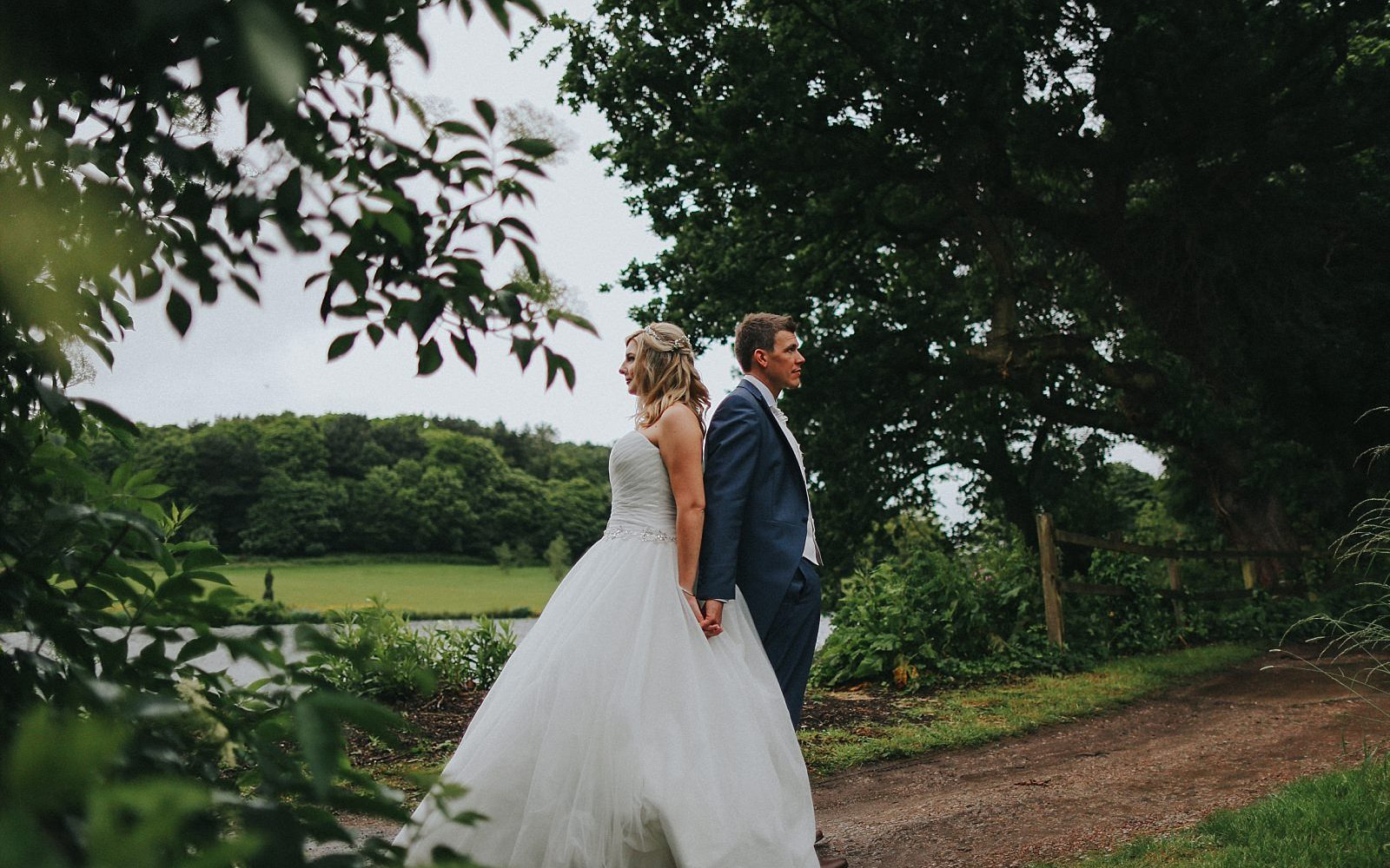 bride and groom pose for couples portraits at shrigley hall golf club