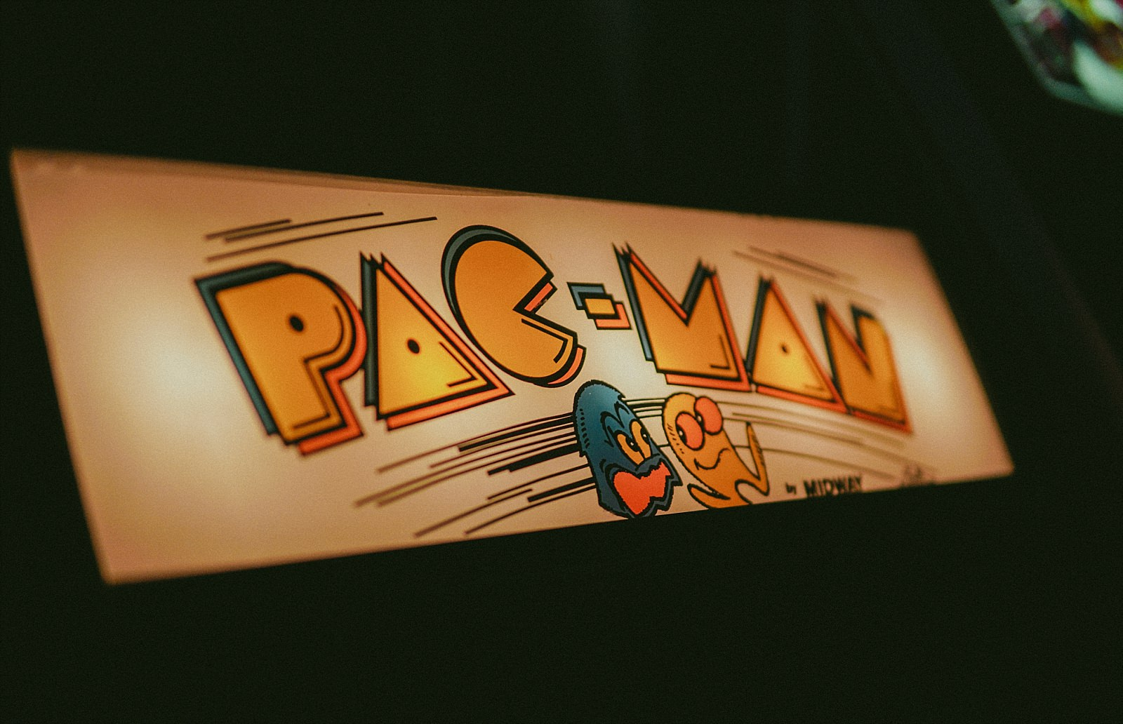 pacman logo on arcade machine