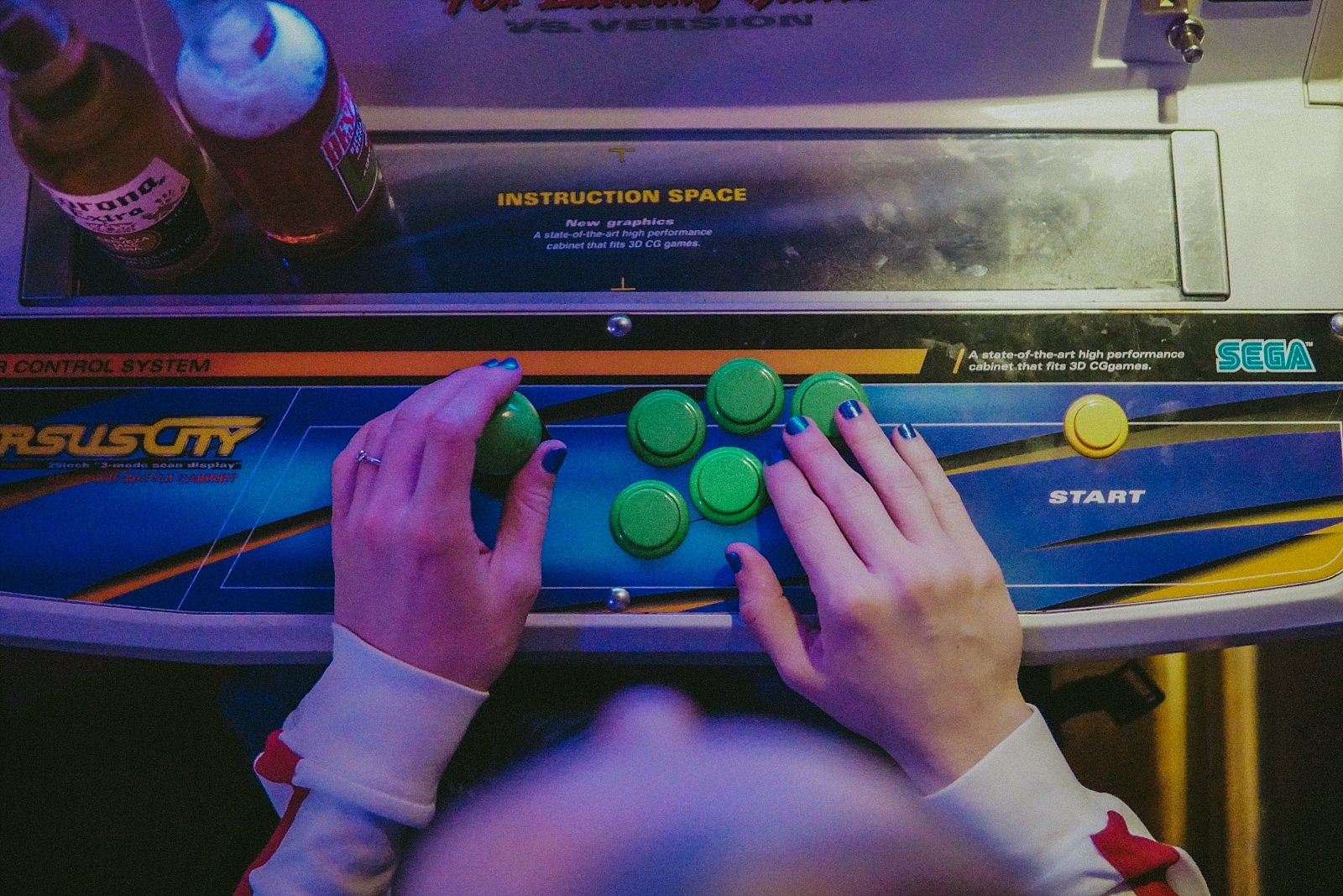 hand playing a retro video game